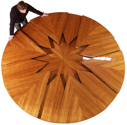 it 39 s a round table that expands in a crazy geometric way when it 39 s